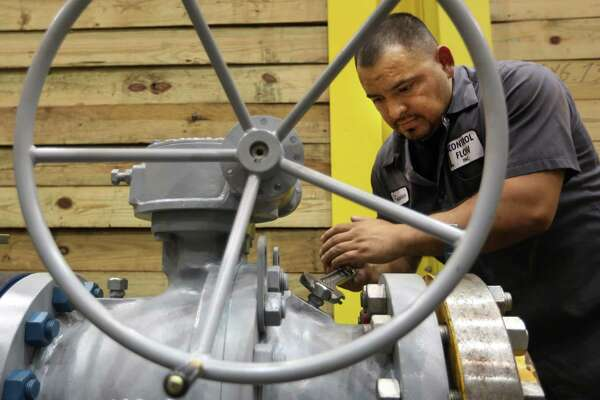 An employee tests an oil well head at Control Flow Inc. in Houston, one of many businesses that was affected in 2015 by a shutdown of the Export-Import Bank.