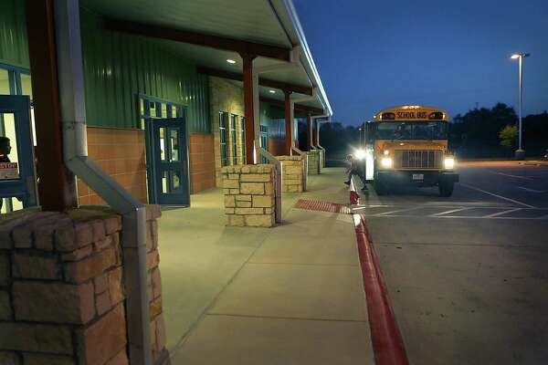 A student gets off a school bus at Rahe Bulverde Elementary School in the Comal ISD in 2015. The district is growing much and fast, why this year's bond measure is crucial.