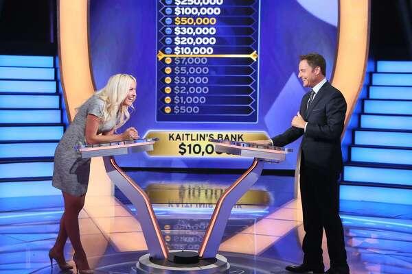 "Kaitlin Roig-DeBellis with ""Millionaire"" host Chris Harrison"