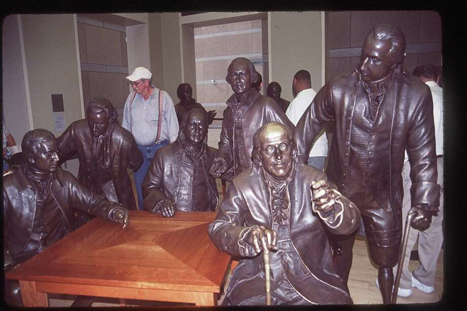 Elitism occurred at the very beginning of the country's creation — only white males with property could be one of the founding fathers. A statue of Benjamin Franklin sits amid the Founding Fathers in the National Constitution Center in Philadelphia in 2005/ Photo: ANNE CHALFANT /KRT / CONTRA COSTA TIMES