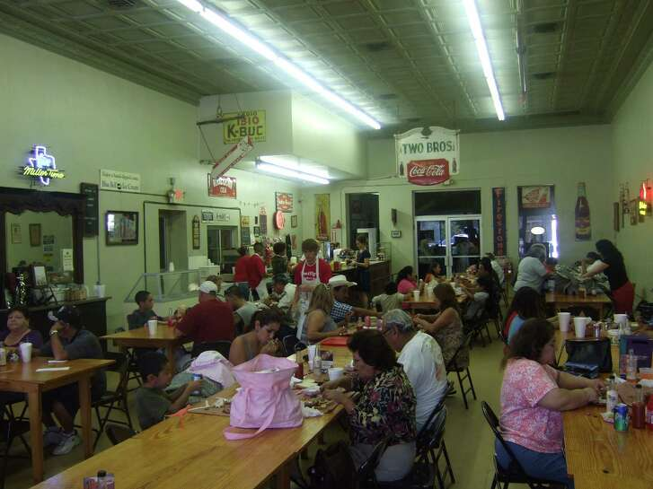 Customers enjoy barbecue at Smitty's Market in Lockhart, Texas.