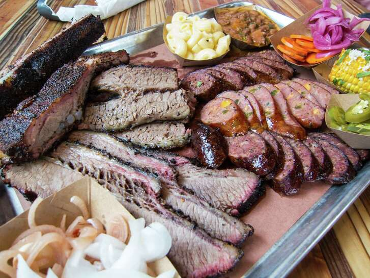 Brisket, pork ribs, sausage and sides at The Pit Room