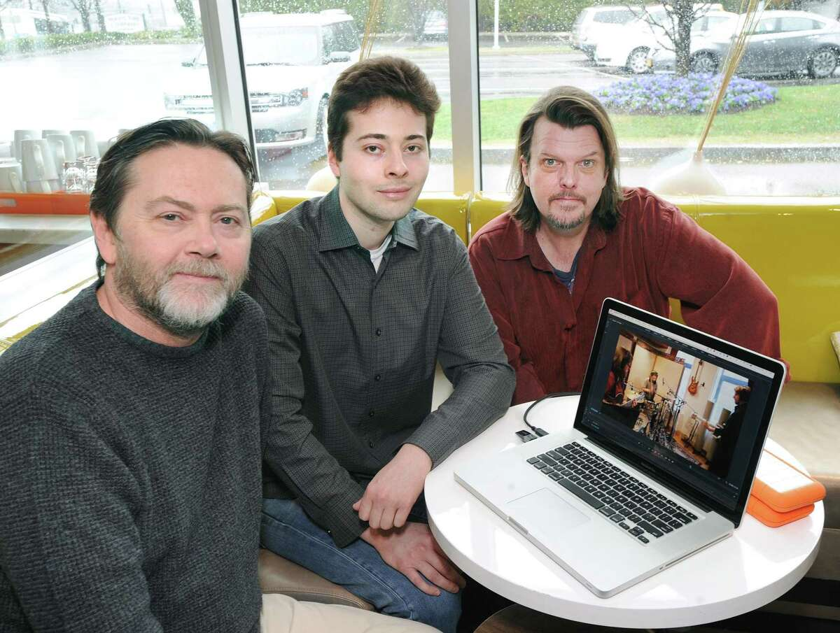 Music producers left to right, Tony Gillis, his son Christian Gillis and David Dill, with a video of their new music project at the J House Greenwich in Greenwich, Conn., Thursday, April 6, 2017.