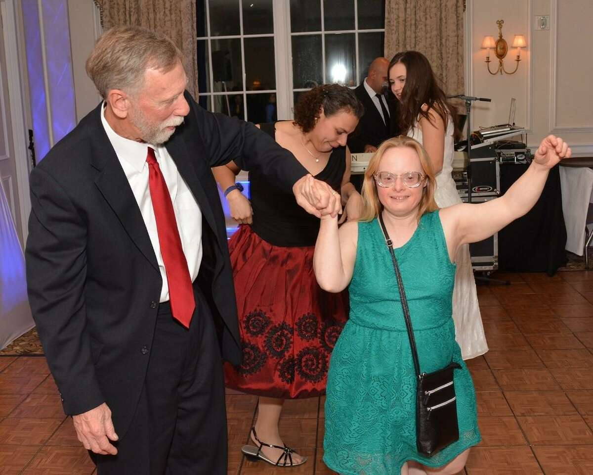 Barry Bosworth of Wilton and daughter Cat enjoy a dance.