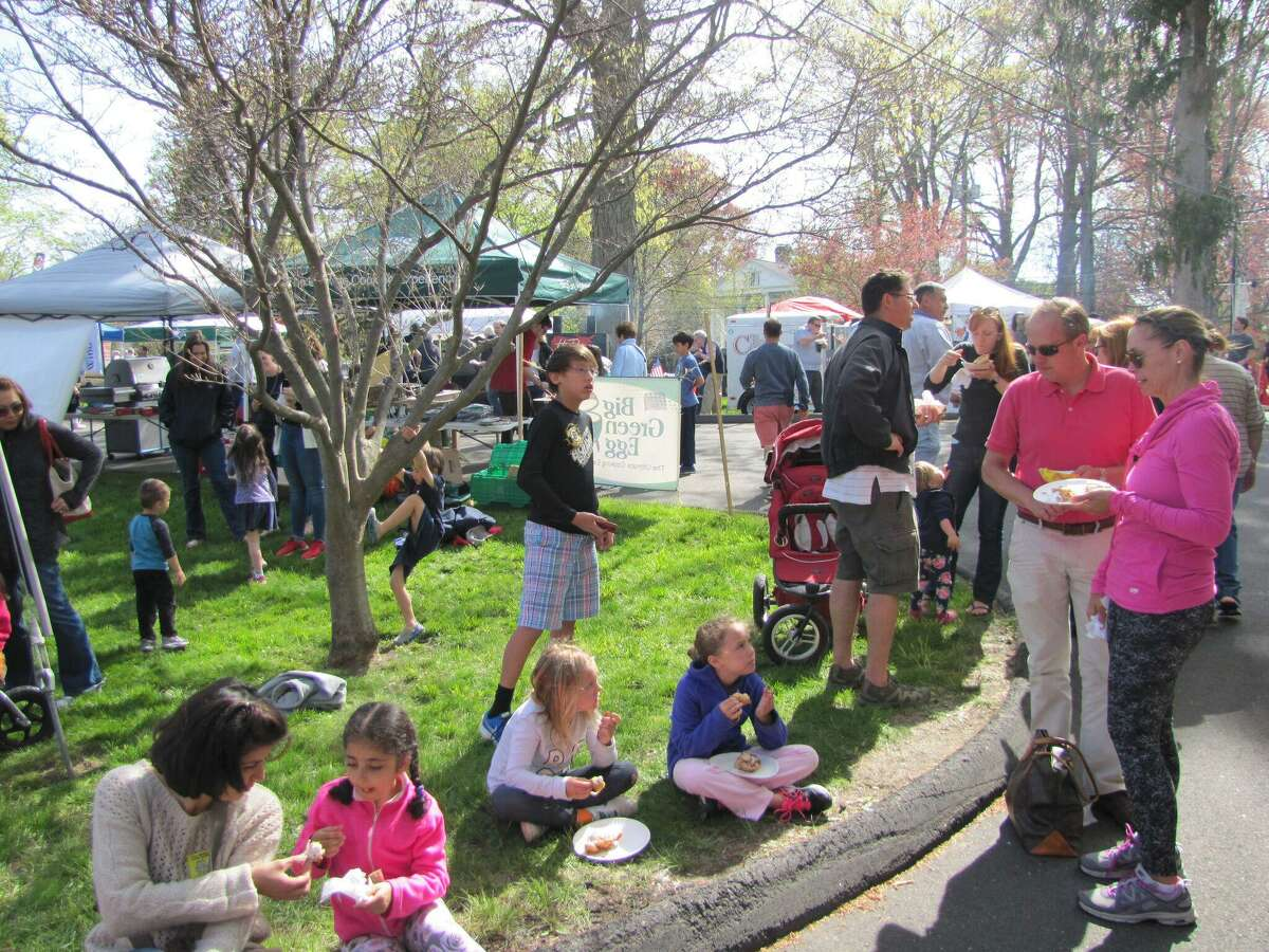 The 4th Annual Ridgefield Gone Country BBQ Festival takes place at the Lounsbury House on Saturday and Sunday, May 6 and 7. Families are seen here enjoying the offerings at last year's festival.