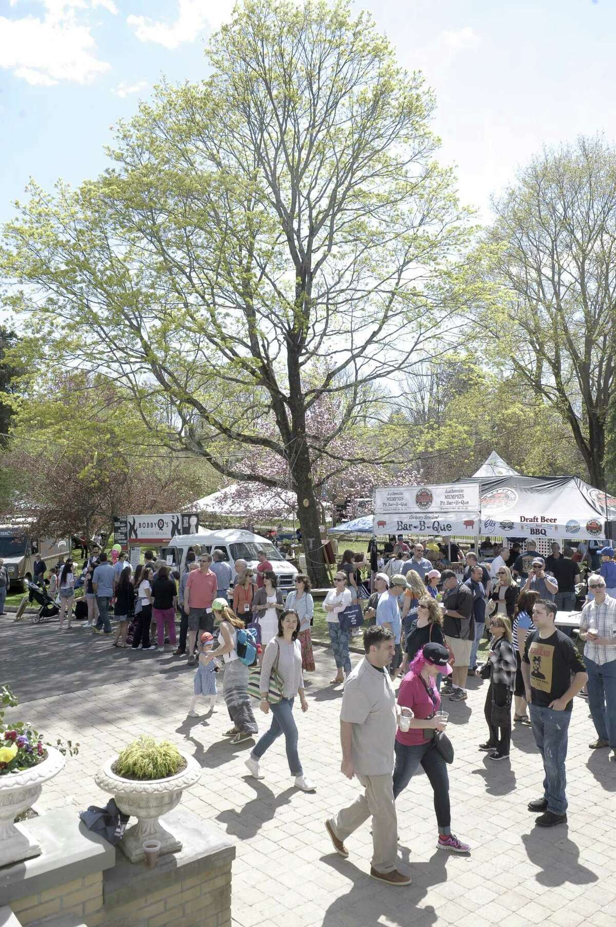 The 4th Annual Ridgefield Gone Country BBQ Festival takes place at the Lounsbury House on Saturday and Sunday, May 6 and 7. Visitors are seen here enjoying the offerings at the 2015 festival.