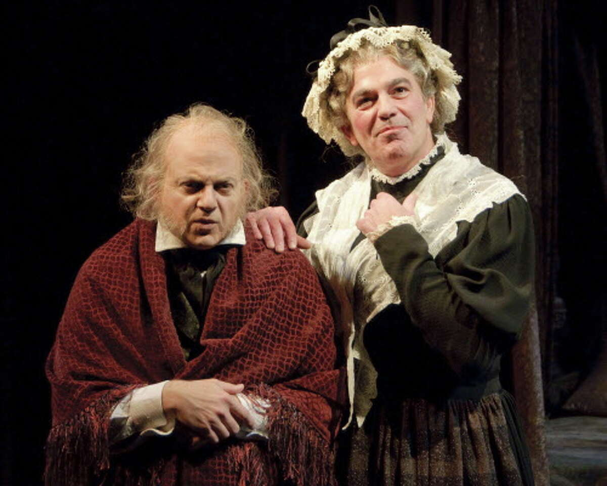 """(L-R) Jeffrey Bean as Ebenezer Scrooge and John Feltch as Mrs. Dilber in the Alley Theatre's """"A Christmas Carol - A Ghost Story of Christmas."""" A Christmas Carol runs on the Alley's Hubbard Stage November 16 - December 24, 2012. Photo by Mike McCormick."""