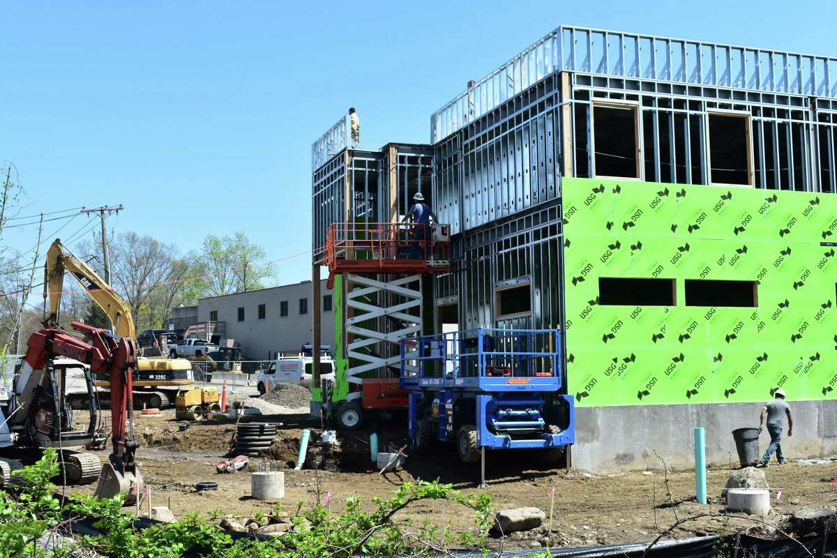 Crews continue work Friday, April 28, 2017, on a planned Chick-fil-A restaurant at 467 Connecticut Ave.