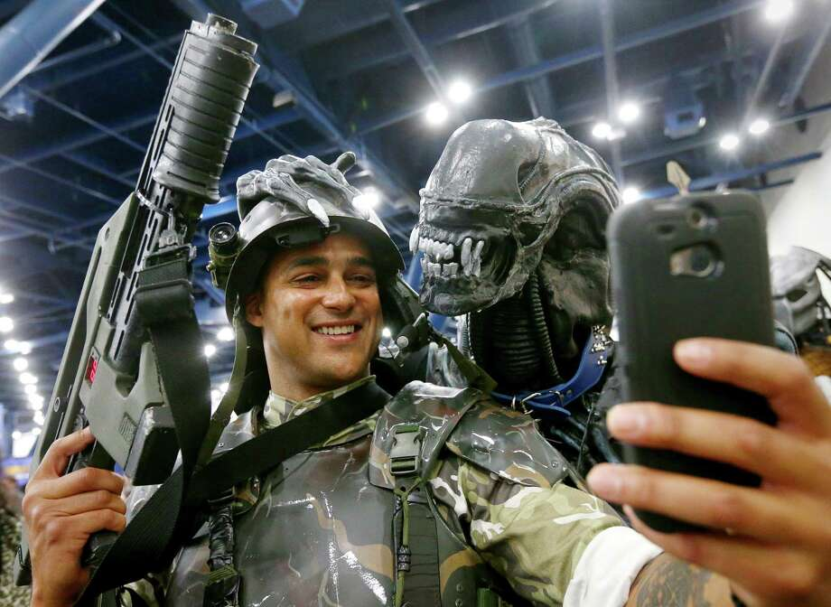 Bobby Easley, from Indianapolis, poses for a photo with an alien at Comicpalooza, at the George R. Brown Convention Center, Saturday, June 18, 2016, in Houston. ( Jon Shapley / Houston Chronicle ) Photo: Jon Shapley, Staff / © 2015  Houston Chronicle