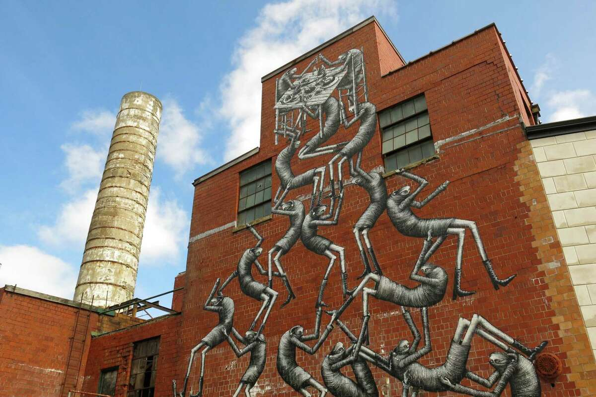 Imaginative graffiti covers the exterior of Etheral Brewing in Lexington's Distillery District.