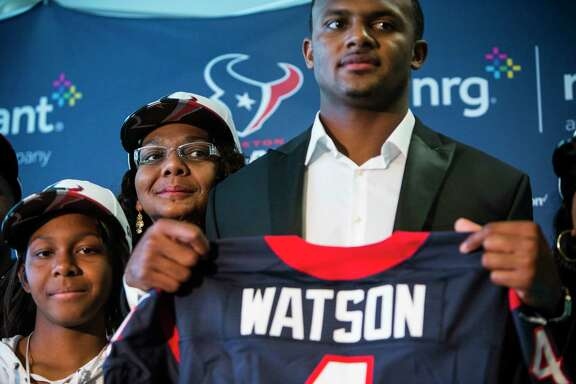 Houston Texans top draft pick Deshaun Watson poses for photos with his family following a news conference at NRG Stadium on Friday, April 28, 2017, in Houston. The Texans traded up in the NFL Draft with the Cleveland Browns to aquire the quarterback from Clemson.