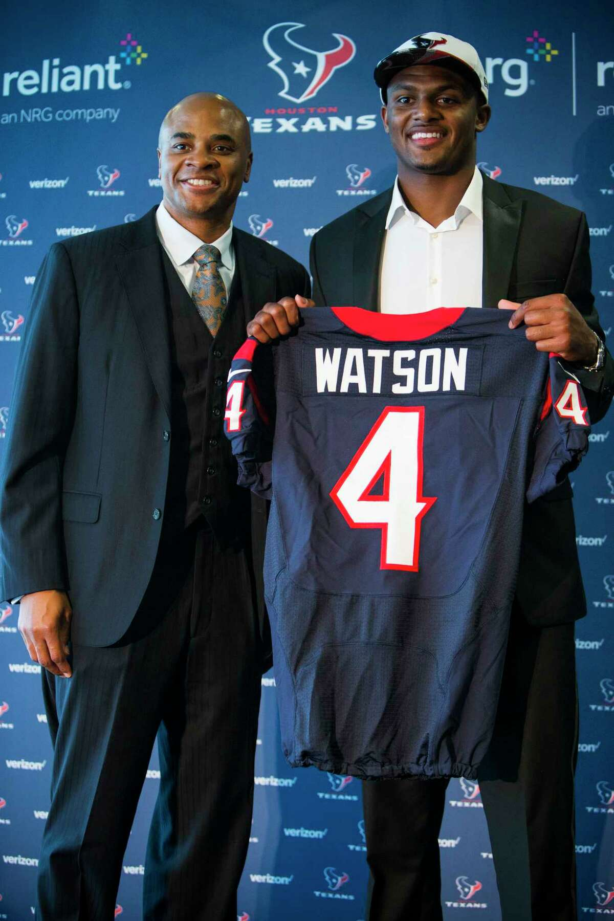 Houston Texans top draft pick Deshaun Watson shows off his new Texans jersey as he poses for a photo with general manager Rick Smith following a news conference at NRG Stadium on Friday, April 28, 2017, in Houston. The Texans traded up in the NFL Draft with the Cleveland Browns to aquire the quarterback.
