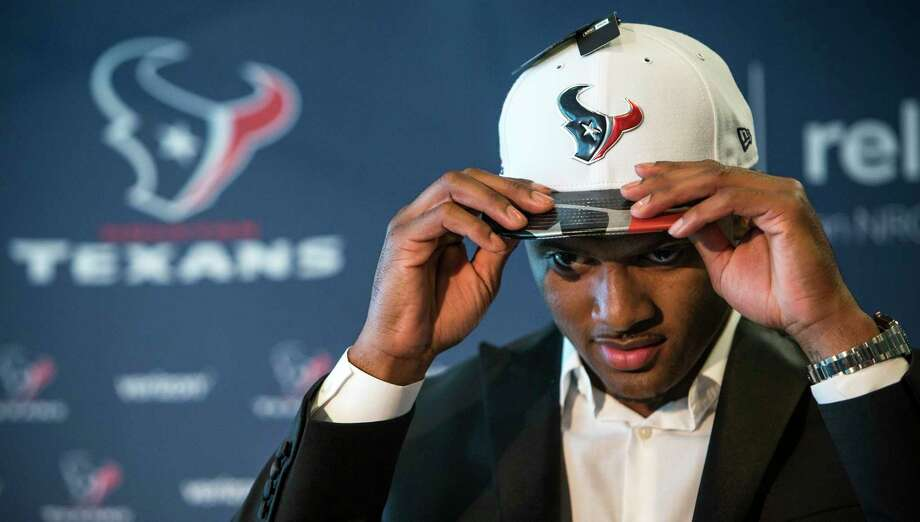 Houston Texans top draft pick Deshaun Watson dons his new Texans cap following a news conference at NRG Stadium on Friday, April 28, 2017, in Houston. The Texans traded up in the NFL Draft with the Cleveland Browns to aquire the quarterback. Photo: Brett Coomer, Houston Chronicle / © 2017 Houston Chronicle