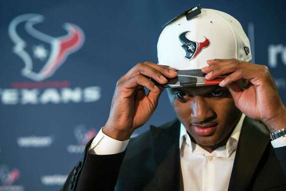 Houston Texans top draft pick Deshaun Watson dons his new Texans cap following a news conference at NRG Stadium on Friday, April 28, 2017, in Houston. The Texans traded up in the NFL Draft with the Cleveland Browns to aquire the quarterback.