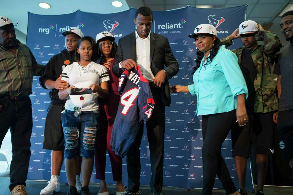 Houston Texans top draft pick Deshaun Watson gets ready to pose for photos with his family following a news conference at NRG Stadium on Friday, April 28, 2017, in Houston. The Texans traded up in the NFL Draft with the Cleveland Browns to aquire the quarterback from Clemson.