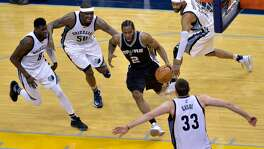 San Antonio Spurs forward Kawhi Leonard (2) drives to the basket between Memphis Grizzlies forward James Ennis (8), forward Zach Randolph (50), guard Vince Carter (15), and center Marc Gasol (33) during the second half of Game 6 in an NBA basketball first-round playoff series Thursday, April 27, 2017, in Memphis, Tenn. The Spurs won 103-96 and advanced to the second round.