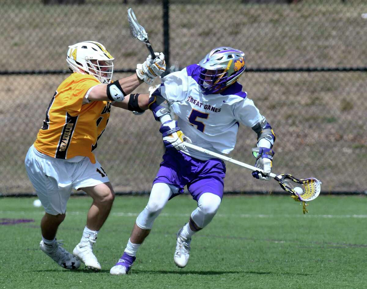 UMBC's Mason Witzler (14) defends against UAlbany's Connor Fields (5) during a NCAA Division I men's lacrosse game on Saturday, April 7, 2017, in Albany, N.Y. (Hans Pennink / Special to the Times Union) ORG XMIT: HP115