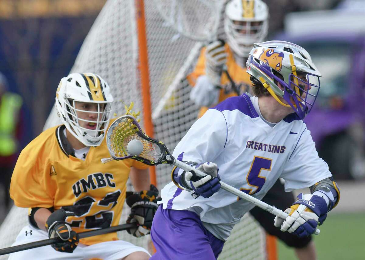 UAlbany's Connor Fields (5) moves the ball infront of the UMBC goal during a NCAA Division I men's lacrosse game on Saturday, April 7, 2017, in Albany, N.Y. (Hans Pennink / Special to the Times Union) ORG XMIT: HP125