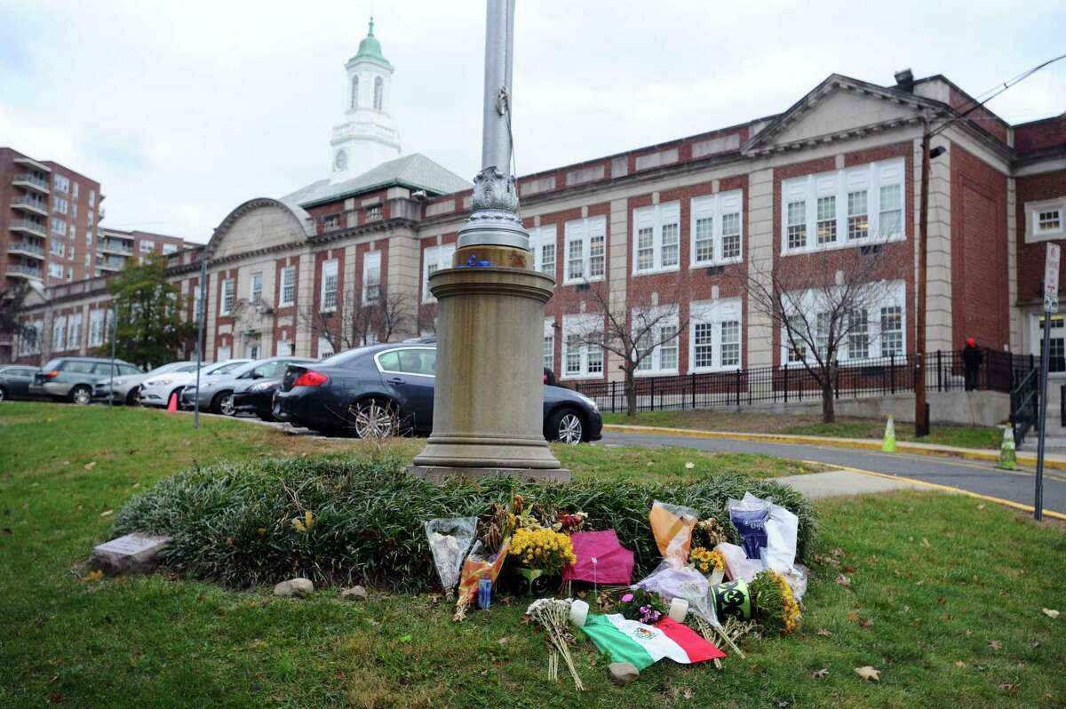 A memorial for Karina Tinajero-Arreguin sits on the front lawn of Stamford High School in Stamford, Conn. on Thursday, Dec. 1, 2016. Tinajero-Arreguin was struck by a vehicle and killed on Strawberry Hill Ave. on Nov. 5.