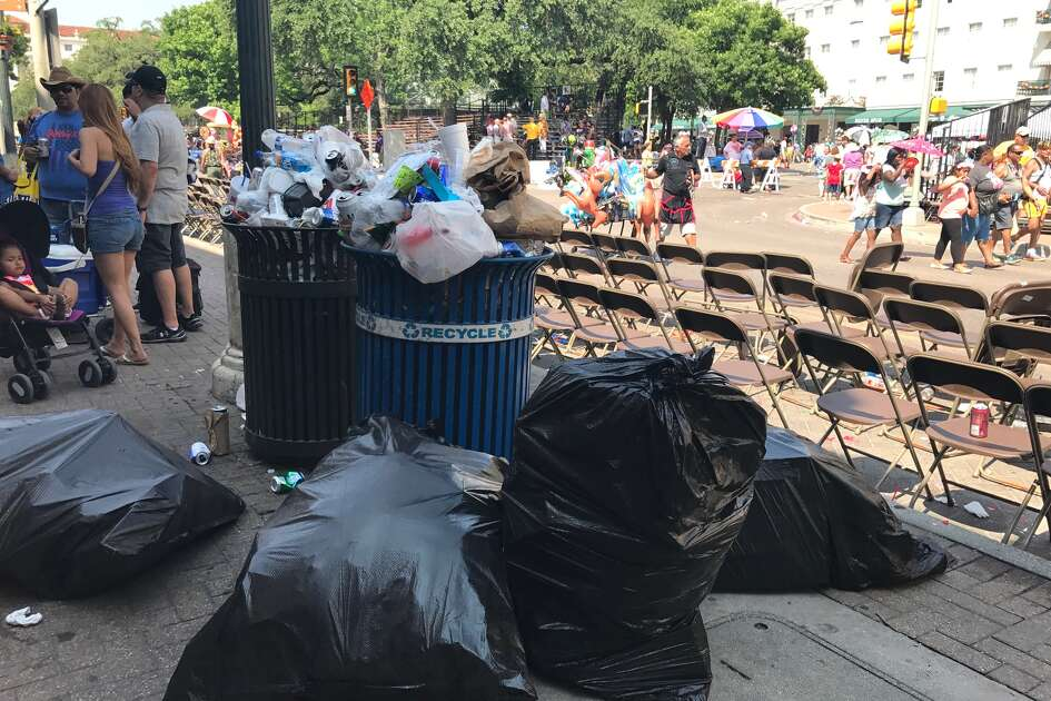 Trash cleanup ensues following the Battle of Flowers Parade, April 28, 2017.