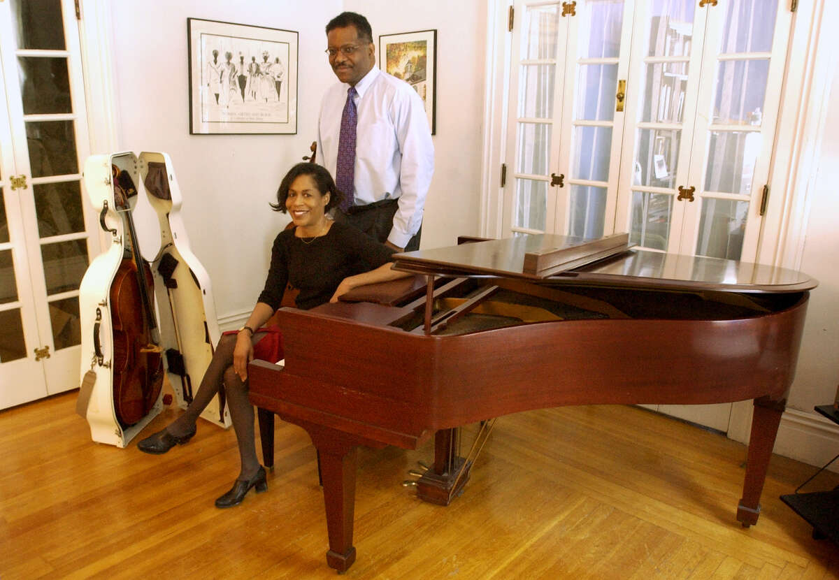Isom, right, and Myra Herron in the music room of their home on Friday, Dec. 19, 2003, in Troy, N.Y. (Will Waldron/Times Union)