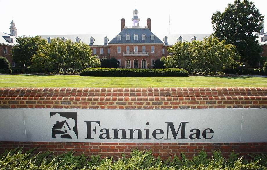 FILE - This Monday, Aug. 8, 2011, file photo, shows the Fannie Mae headquarters in Washington.  Fannie Mae, the government-controlled mortgage company, said its net income in the fourth quarter nearly doubled on higher interest rates. It also said Friday, Feb. 19, 2016 that it expects to pay the U.S. Department of Treasury $2.9 billion in dividends next month.(AP Photo/Manuel Balce Ceneta) Photo: Manuel Balce Ceneta, AP