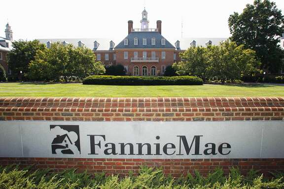FILE - This Monday, Aug. 8, 2011, file photo, shows the Fannie Mae headquarters in Washington.  Fannie Mae, the government-controlled mortgage company, said its net income in the fourth quarter nearly doubled on higher interest rates. It also said Friday, Feb. 19, 2016 that it expects to pay the U.S. Department of Treasury $2.9 billion in dividends next month.(AP Photo/Manuel Balce Ceneta)