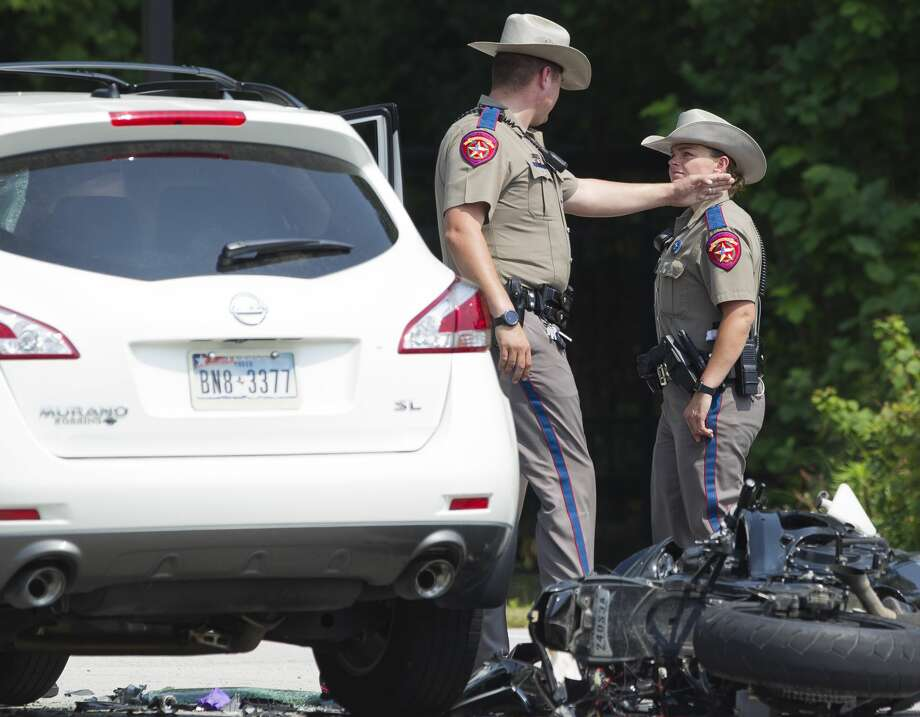 Texas State Troopers investigate the scene of a fatal motorcycle crash near Riley Fuzzel Road and the Grand Parkway, Friday, April 28, 2017, in Spring. Photo: Jason Fochtman/Houston Chronicle
