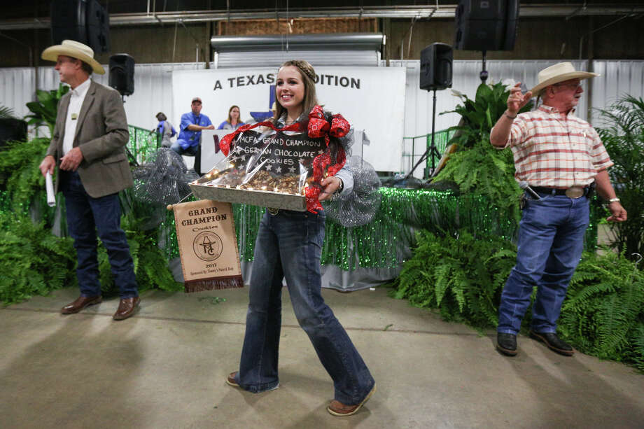 New Caney FFA's Maci Loving presents her grand champion cookies during the Non-Livestock Auction on Monday, April 3, 2017, at the Montgomery County Fairgrounds. Photo: Michael Minasi, Staff Photographer / © 2017 Houston Chronicle