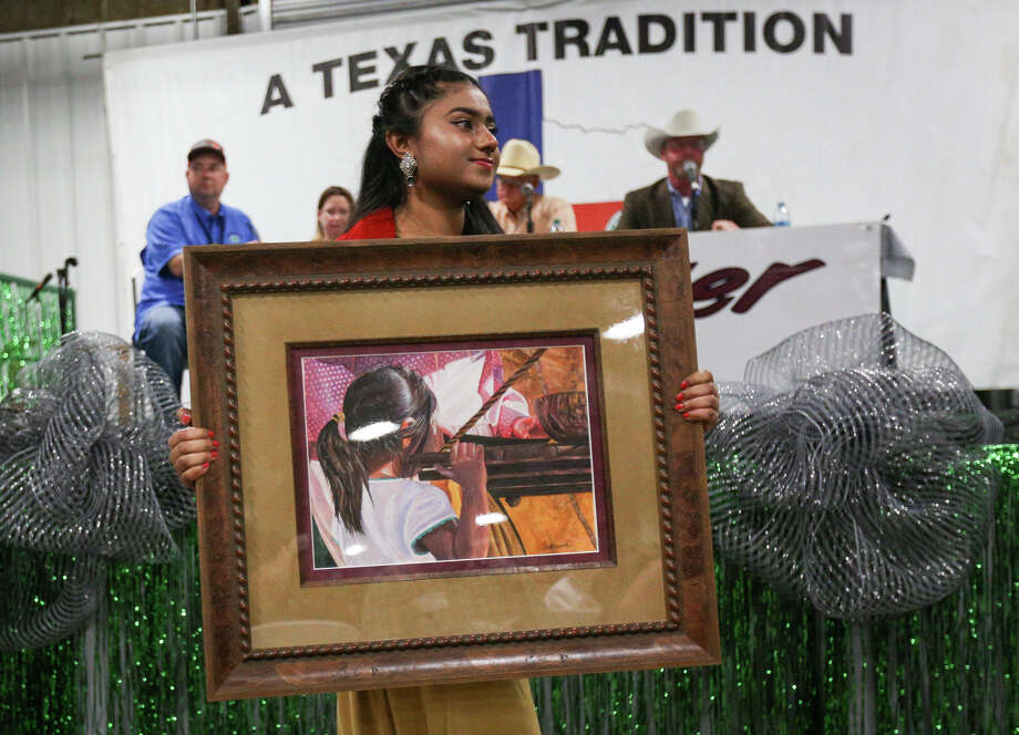 Porter High School's Tasnuva Haider presents her grand champion Fine Art piece during the Non-Livestock Auction on Monday, April 3, 2017, at the Montgomery County Fairgrounds. Photo: Michael Minasi, Staff Photographer / © 2017 Houston Chronicle