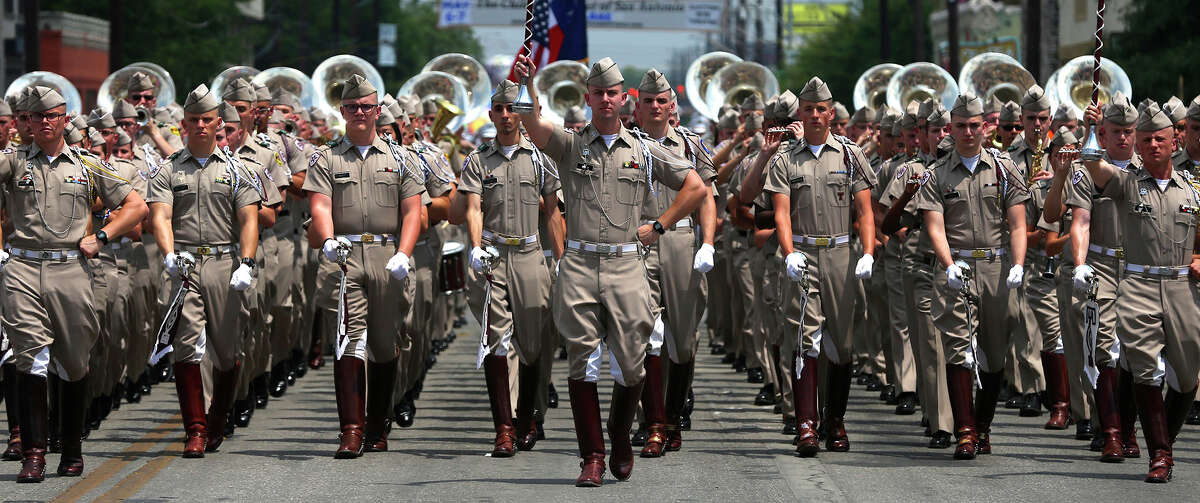 The Fightin' Texas Aggie Band marches through downtown San Antonio during the Battle of Flowrrs Parade Friday April 28, 2017.
