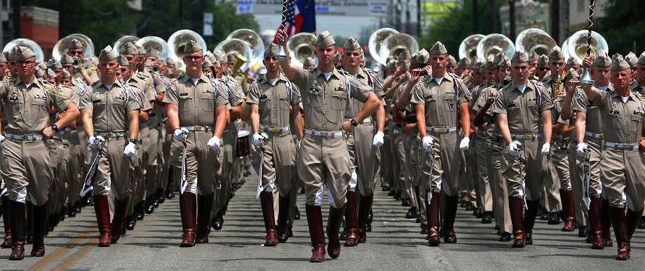 The Fightin' Texas Aggie Band marches through downtown San Antonio during the Battle of Flowrrs Parade Friday April 28, 2017. Photo: John Davenport, San Antonio Express-News / ©San Antonio Express-News/John Davenport