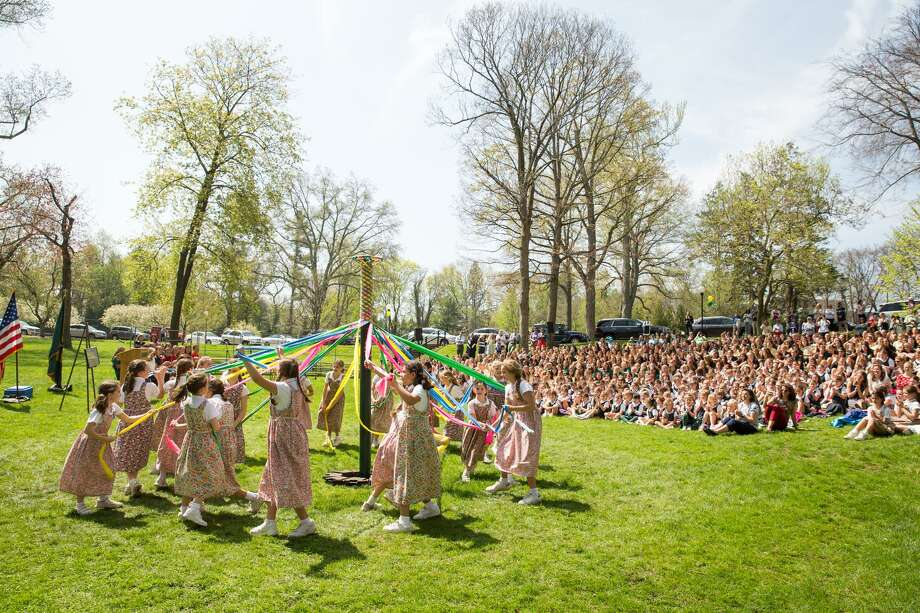 Students dance around the Maypole during the celebration of Charter Day, Greenwich Academy's 190th birthday. Photo: Chris Palermo / For Hearst Connecticut Media / Greenwich Time Freelance