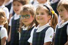 """Mara Kruzer, right, and Sabrina Maddock, left sing """"Happy Birthday, Greenwich Academy"""" with her classmates during the celebration of Charter Day, Greenwich Academy's  190th birthday on Friday, April 28, 2017."""