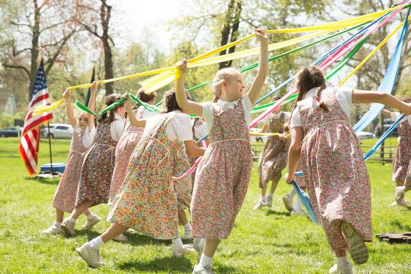 Students dance around the Maypole during the celebration of Charter Day, Greenwich Academy's 190th birthday on Friday, April 28, 2017.