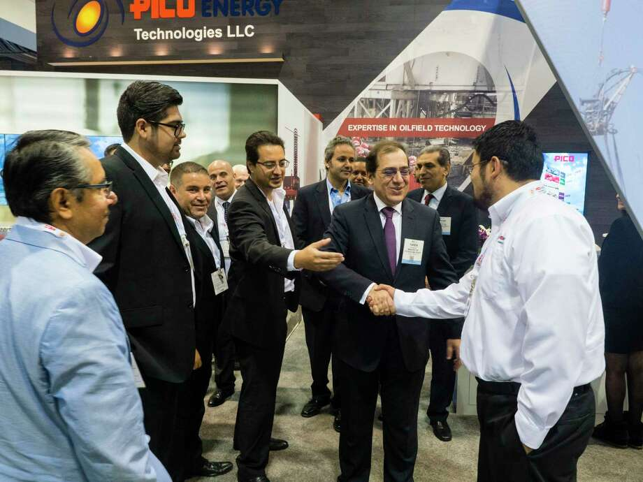 Staff and Egyptian oil minister gathered during the Exhibits at the Offshore Technology Conference 2016. / © OTC/Todd Buchanan 2016