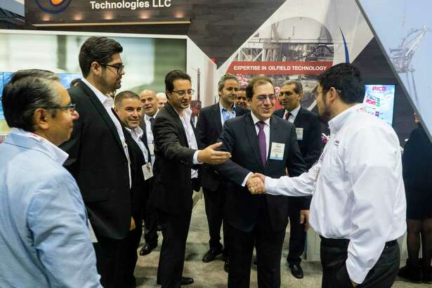Staff and Egyptian oil minister gathered during the Exhibits at the Offshore Technology Conference 2016.