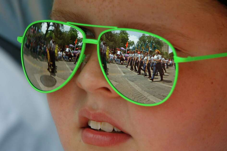 Mason Hix,9, watches the Battle of Flowers  Parade on Friday, April 28, 2017.
