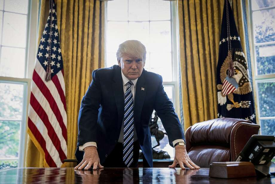 President Donald Trump poses for a portrait in the Oval Office in Washington, Friday, April 21, 2017. With his tweets and his bravado, Trump is putting his mark on the presidency in his first 100 days in office. He's flouted conventions of the institution by holding on to his business, hiring family members as advisers and refusing to release his tax returns. He's tested conventional political wisdom by eschewing travel, church, transparency, discipline, consistency and decorum. But the presidency is also having an impact on Trump, prompting him, at times, to  play the role of traditional president. (AP Photo/Andrew Harnik) Photo: Andrew Harnik, Associated Press