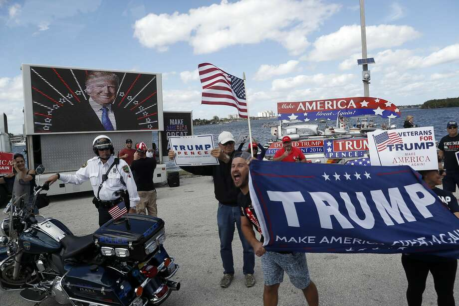 DAY 44 - In this March 4, 2017, file photo supporters of President Donald Trump gather outside Mar-a-Lago in Palm Beach, Fla., where President Donald Trump is spending the weekend. While at Mar-a-Lago, the president did not have any events that were open for media coverage and was not photographed on day 44. (AP Photo/Alex Brandon, File) Photo: Alex Brandon, Associated Press