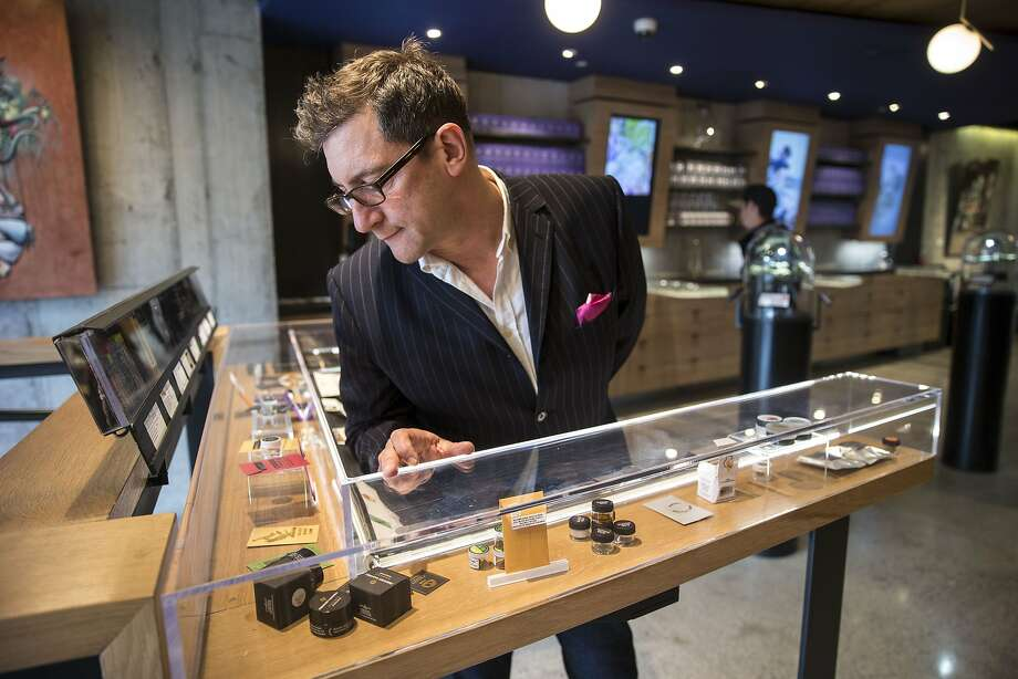 "Joe Dolce, the author of ""Brave New Weed,"" checks out the products on display at Medithrive, a medical marijuana dispensary in San Francisco. Photo: Santiago Mejia, The Chronicle"