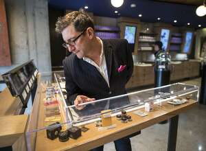 """Joe Dolce checks out the products at Medithrive, a medical marijuana dispensary on Saturday, Oct. 15, 2016 in San Francisco, Calif. Dolce is the author of """"Brave New Weed."""""""
