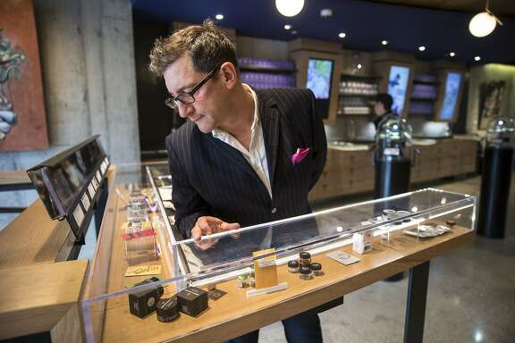 "Joe Dolce checks out the products at Medithrive, a medical marijuana dispensary on Saturday, Oct. 15, 2016 in San Francisco, Calif. Dolce is the author of ""Brave New Weed."""