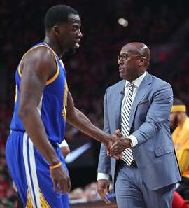 Golden State Warriors' Draymond Green and interim head coach Mike Brown against Portland Trail Blazers in Game 4 of NBA Western Conference 1st Round Playoffs at Moda Center in Portland, Oregon on Monday, April 24, 2017.