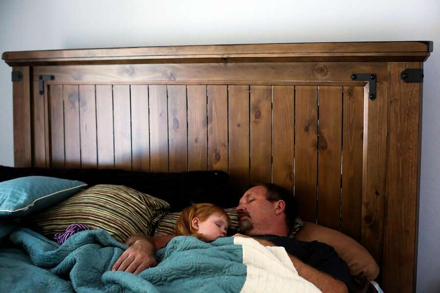 Brooke Adams, 3, takes a nap with her father Jon Adams after attending church in Santa Rosa, California, on Sunday, April 9, 2017. Brooke has Dravet's syndrome which causes severe epilepsy among other issues. She takes cannabis oil several times a day and when she has seizures. The cannabis oil significantly helps her condition. Photo: Gabrielle Lurie, The Chronicle