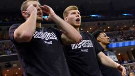 San Antonio Spurs forward David Lee, from left, forward Davis Bertans, and guard Dejounte Murray react from the sideline during the second half of Game 6 in an NBA basketball first-round playoff series against the Memphis Grizzlies Thursday, April 27, 2017, in Memphis, Tenn.