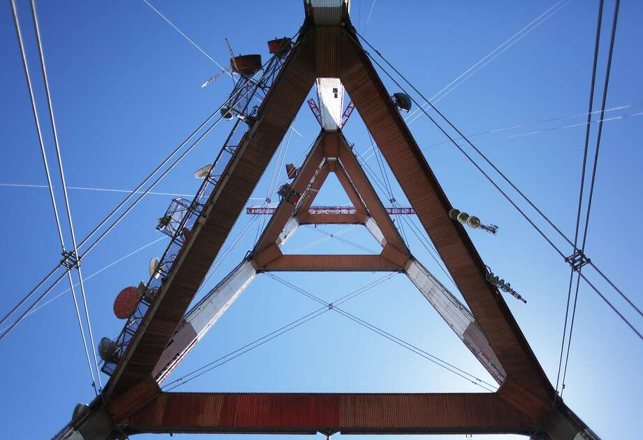 Sutro Tower is seen from below in 2013. The owner of KCSM, which broadcasts from the tower, is embroiled in a legal dispute over the botched sale of the station's wireless spectrum. Photo: Pete Kiehart, The Chronicle