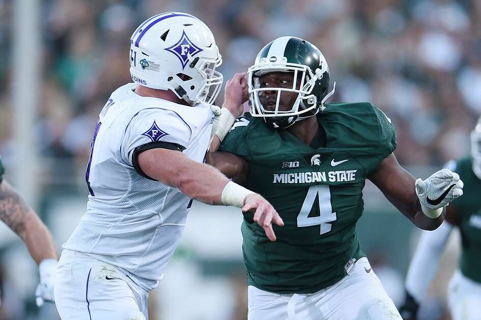 Malik McDowell #4 of the Michigan State Spartans works against Harrison Monk #71 of the Furman Paladins during the first half of a game at Spartan Stadium on September 2, 2016 in East Lansing, Michigan.  (Photo by Stacy Revere/Getty Images)