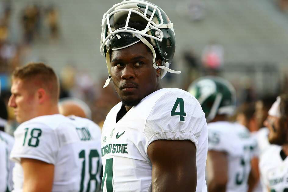 Malik McDowell #4 of the Michigan State Spartans during warmups prior to the game against the Western Michigan Broncos at Waldo Stadium on September 4, 2015 in Kalamazoo, Michigan. (Photo by Rey Del Rio/Getty Images)