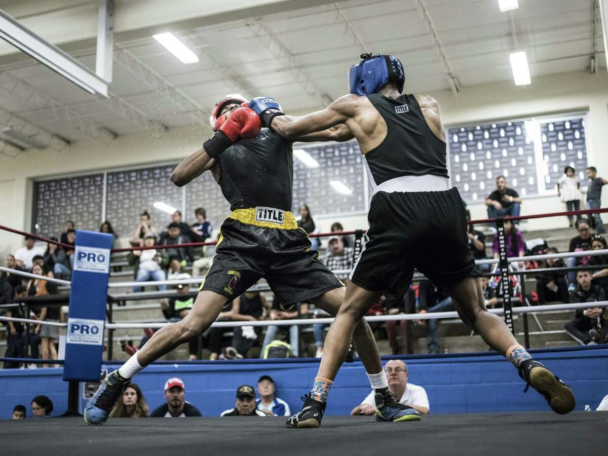 Joseph Barrow Jr. 20, left, with San Fernando Boxing Club, fights against Sim Drain of Bryan College Station, right, during a boxing event at the Lincoln Community Center in San Antonio, Texas on Saturday, March 4, 2017. This was Barrow's first fight ever. He had been training with San Fernando for the past three months.